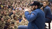 Scarlett Johansson and Chris Evans perform for service members during the USO Holiday Tour at Bagram Air Base, Afghanistan, Dec. 7, 2016. Marine Gen. Joseph F. Dunford, Jr., chairman of the Joint Chiefs of Staff, along with USO entertainers, visited service members who are deployed from home during the holidays at various locations across the globe. This year's entertainers included actors Chris Evans, actress Scarlett Johansson, NBA Legend Ray Allen, 4-time Olympic Medalist Maya DiRado, Country Music Singer Craig Campbell, and mentalist Jim Karol. (DoD photo by Navy Petty Officer 2nd Class Dominique A. Pineiro/Released)